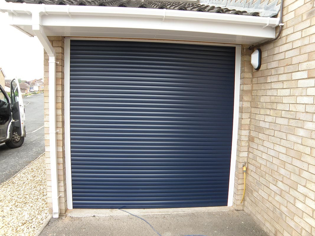 Why choose a roller garage door rollerdor for Garage screen door rollers