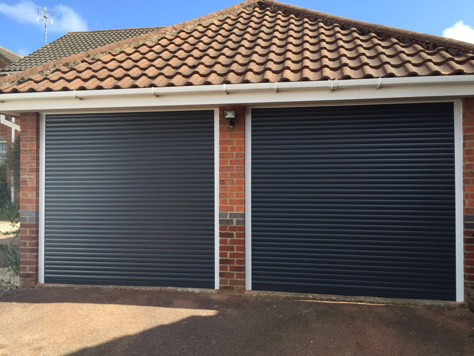 Roller garage door prices price calculator rollerdor for Two door garage