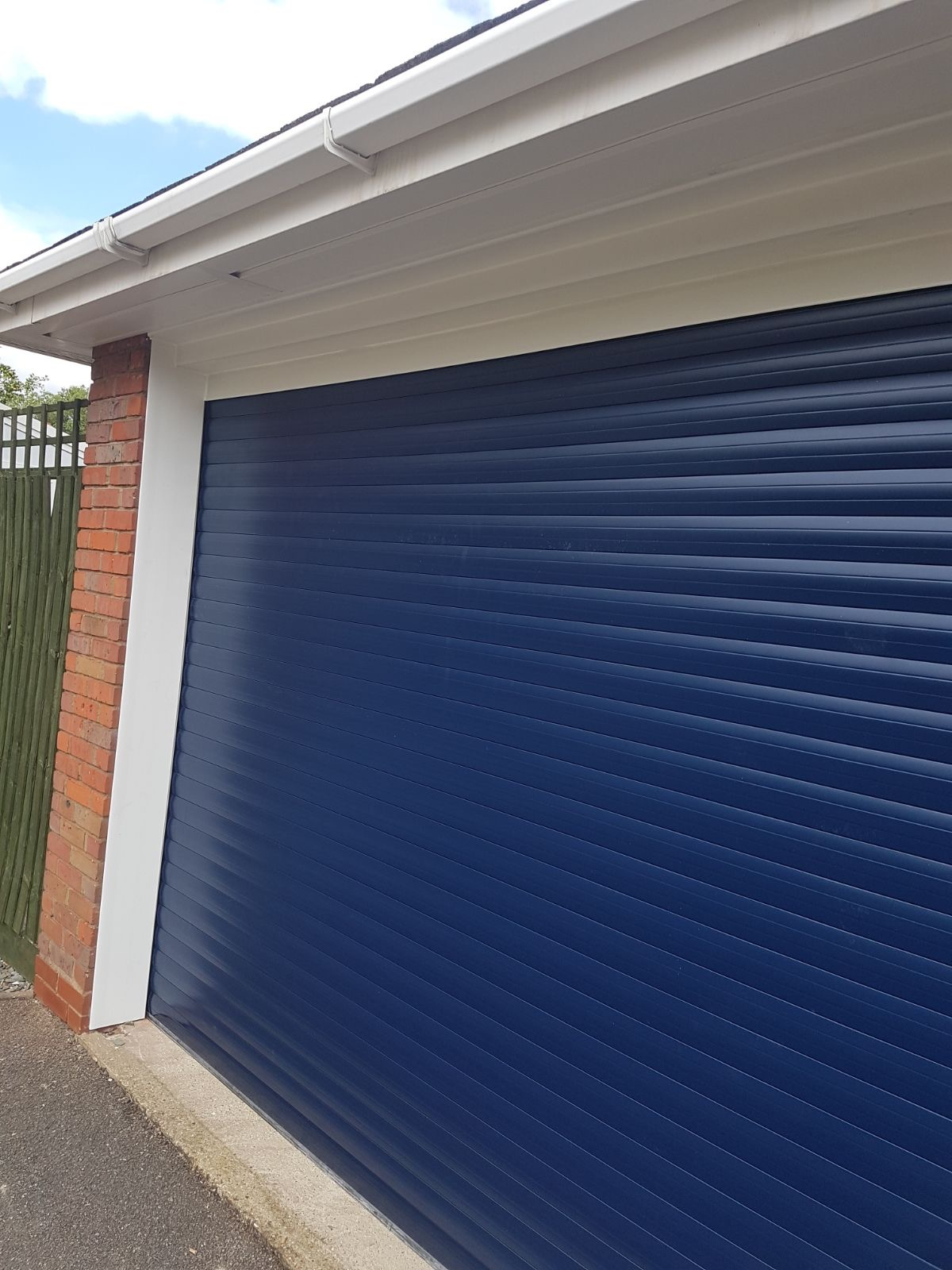 Blue Roller door in blue with white cladding