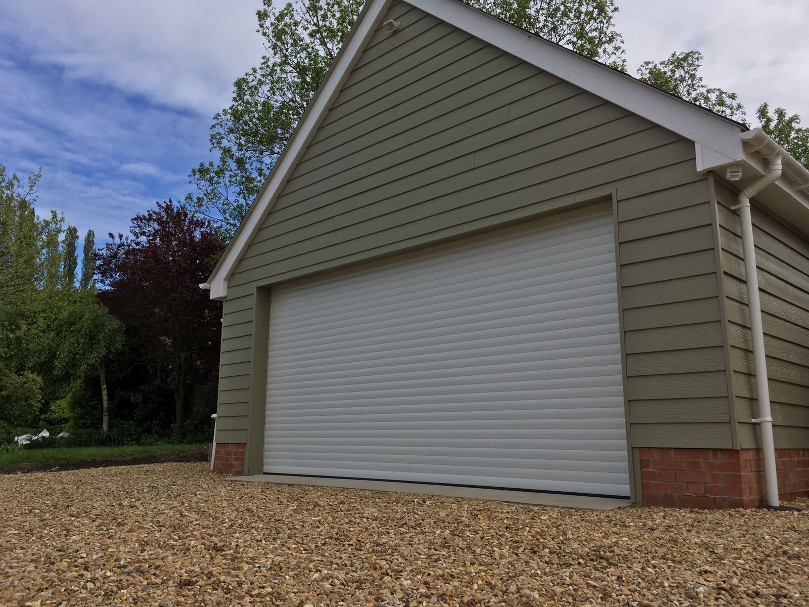 Executive large white single roller garage by Rollerdor Ltd doors
